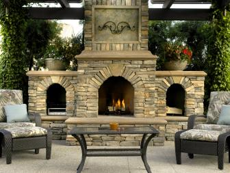 Outdoor Living Room with Stone Fireplace Focal Point