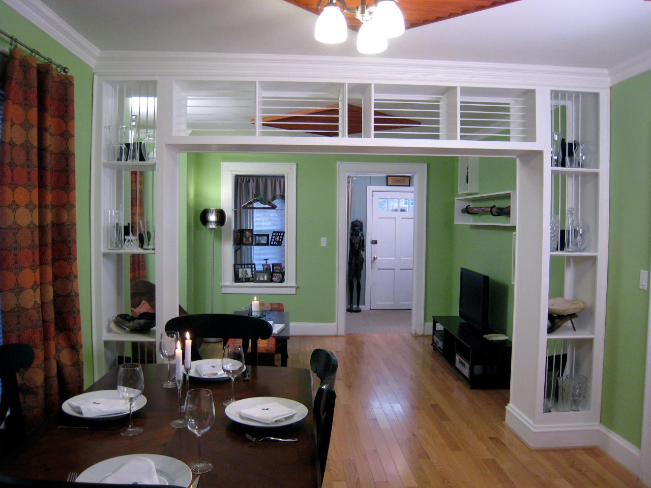 Built in bookcase and room divider hgtv for Living room partition