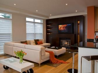 White and Orange Living Room With Wood Wall