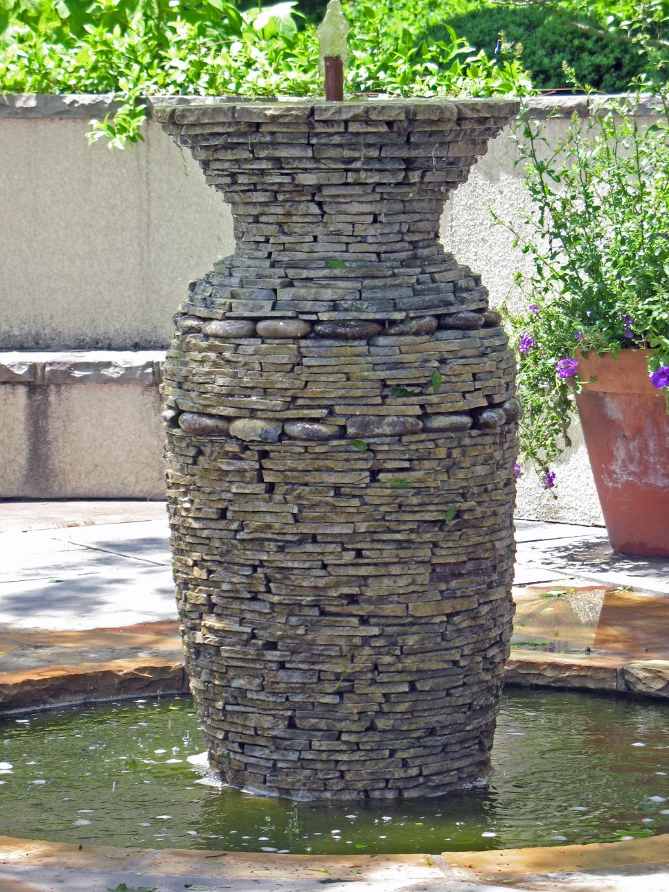 15 unique garden water features hgtv for Garden fountains and water features