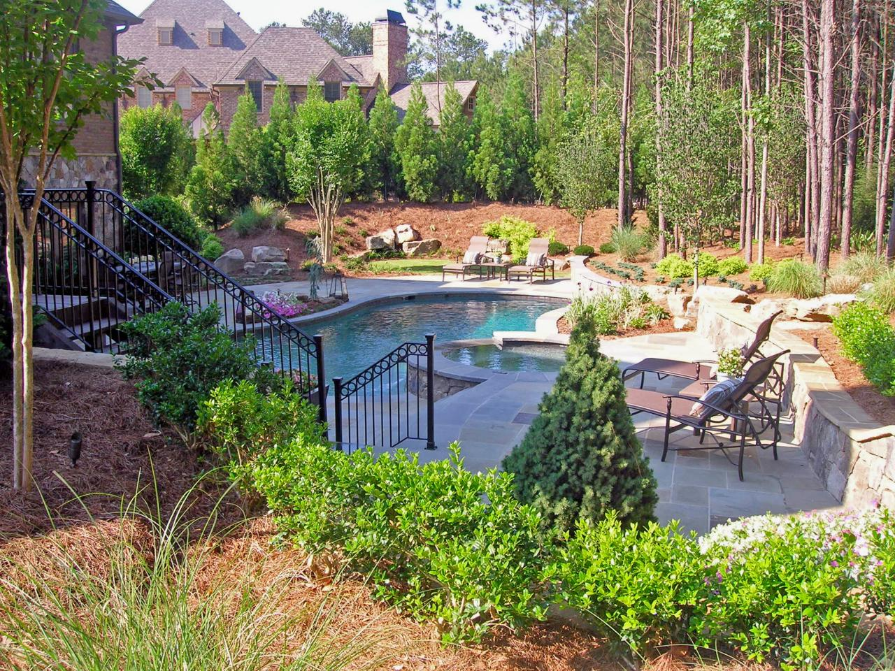 Inspiring backyard designs that incorporate both large and for Berm garden designs