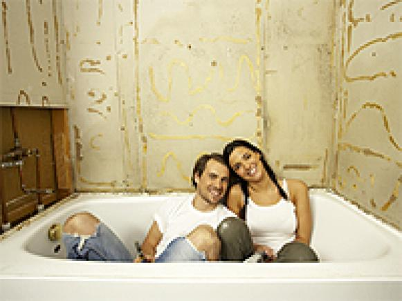 Couple Sitting in White Bathtub