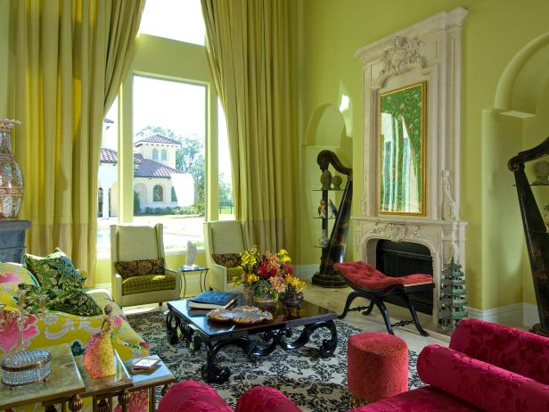 Green Living Room With Draperies, Ornate Fireplace and Fuchsia Chairs
