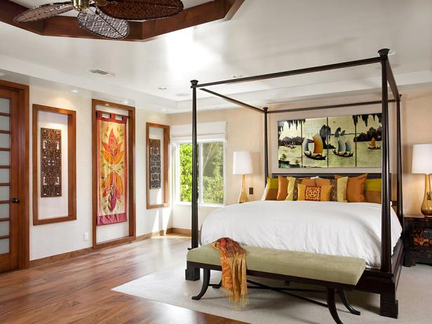 Neutral Resort-Inspired Bedroom With Wood Trim and Dark Canopy Bed