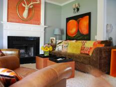 Eclectic Blue Living Room With Orange Pops of Color