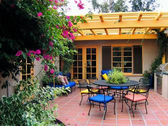 Colorful Outdoor Dining Room With Yellow Pergola