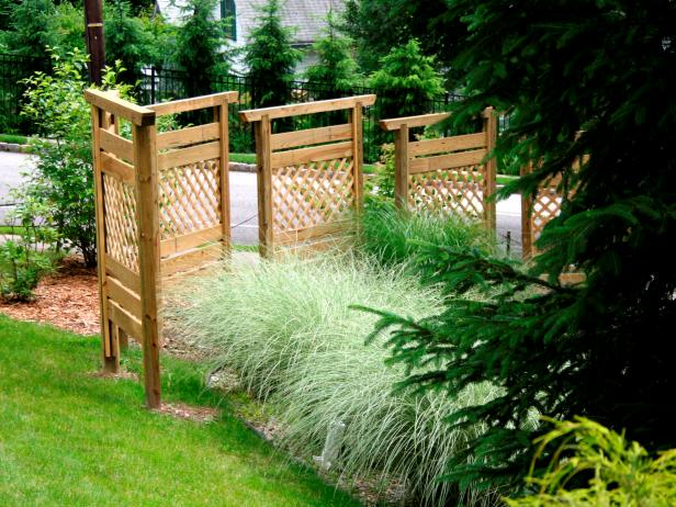 Build a privacy wall with fence panels hgtv for Landscaping ideas for privacy screening