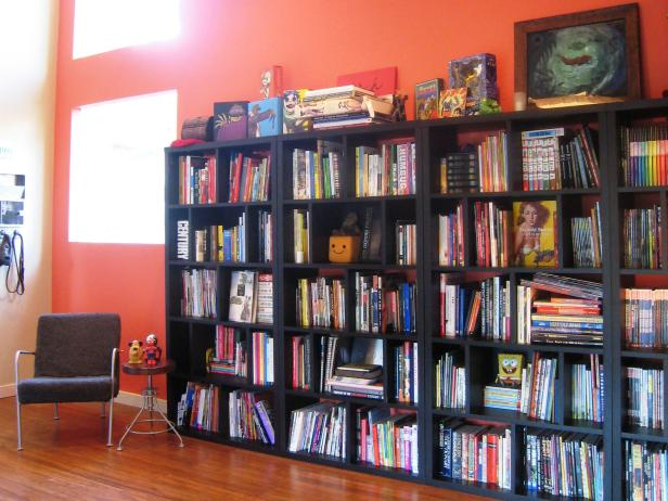 Eclectic Orange Home Office With Bookshelves