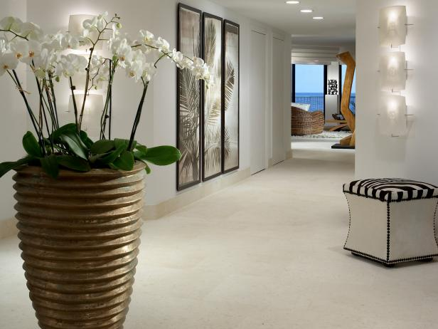 Contemporary White Foyer With Potted Orchids and Art