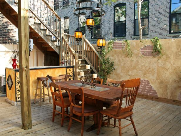 Tuscan Inspired Outdoor Dining Area With Rustic Table Hgtv