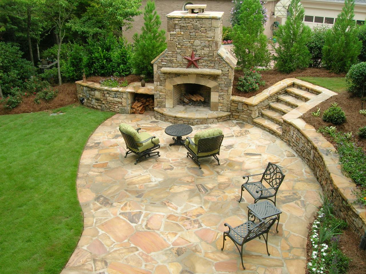 After a beautiful stone patio and fireplace backed by for Patio landscaping