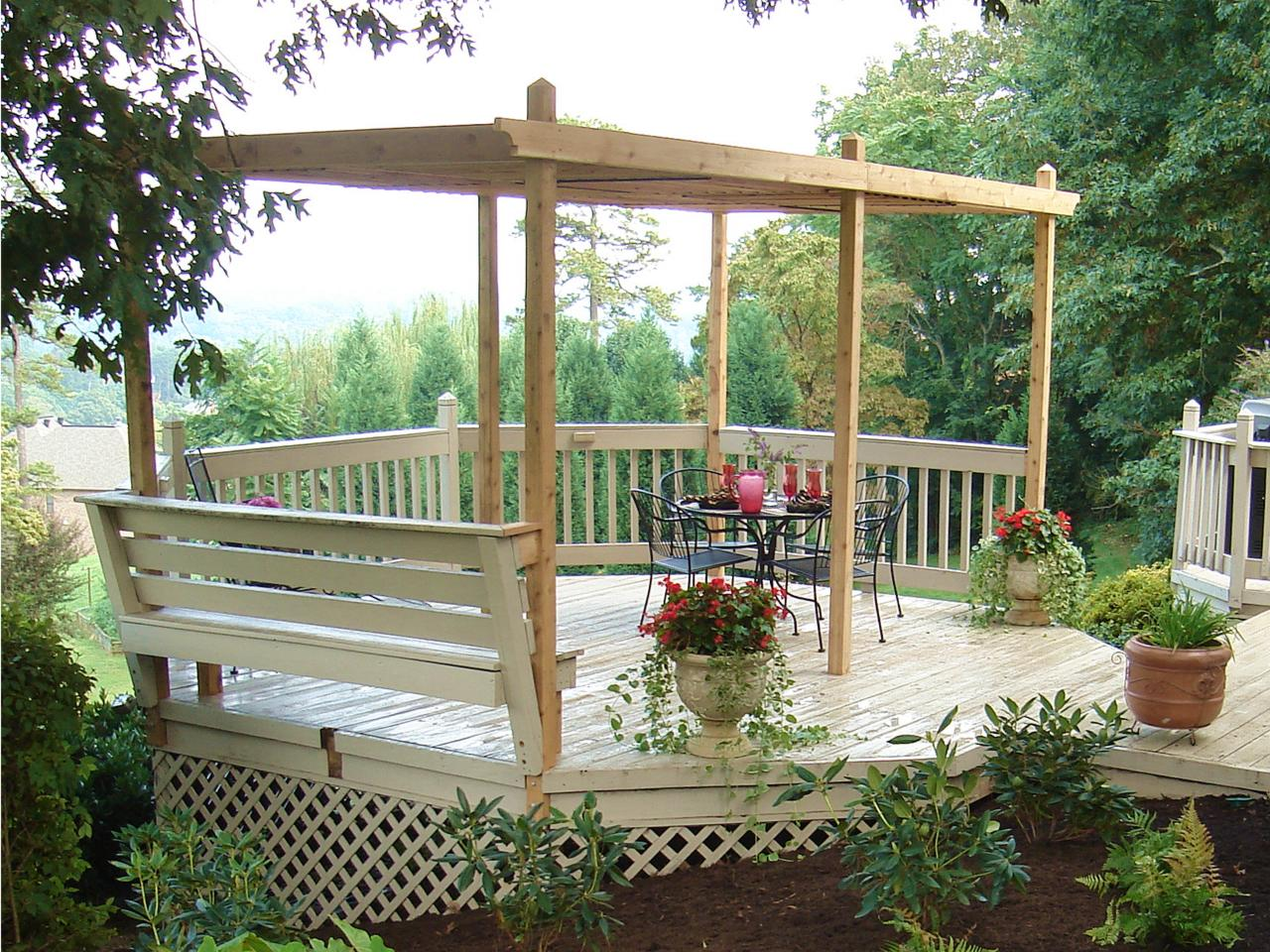 How to build a backyard pergola hgtv - Pergola with roof ...