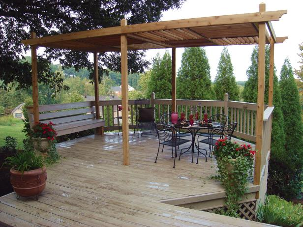 Sit back and enjoy under this beautiful DIY pergola featuring louvered roof panels.