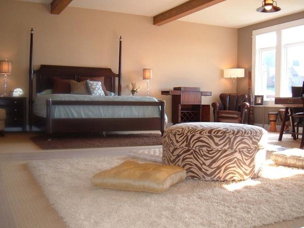 Neutral Bedroom With Two-Poster Bed & Zebra Ottoman