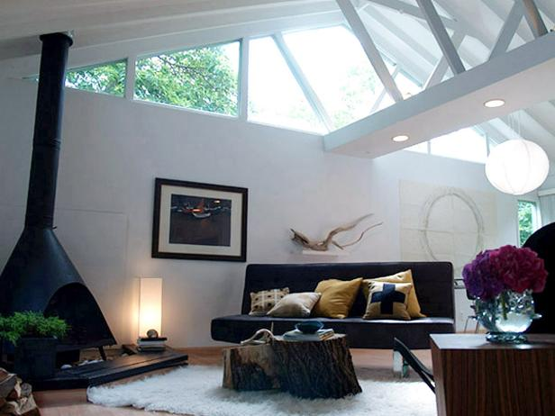White Modern Living Room With Vaulted Ceiling and Black Fireplace