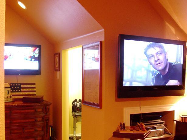Colorful Orange Attic With Flat Panel TVs