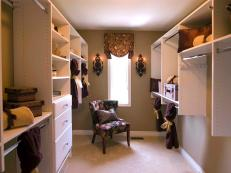Large Walk-In Closet With White Cabinetry