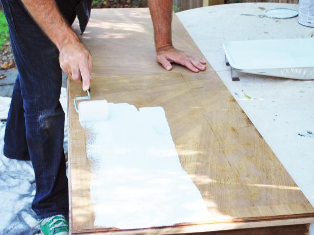 Pour primer into paint pan liner, then use a paint roller to apply a single coat of primer to piece. Paint any remaining areas with one-inch-angled paint brush. Let dry.