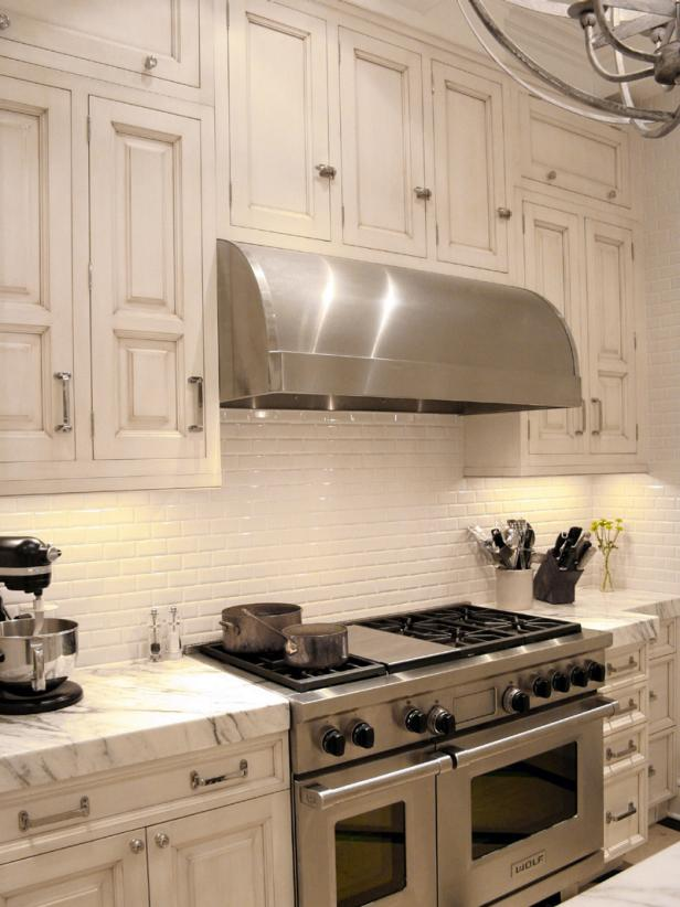 Stainless Steel Cook Range and Hood With Marble Countertops