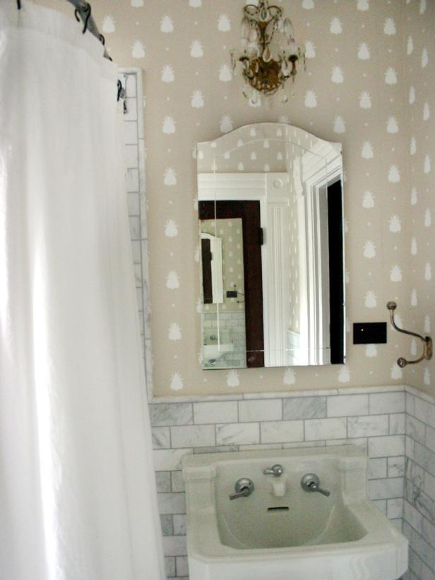 Small Neutral Bathroom With Glamorous Sconce