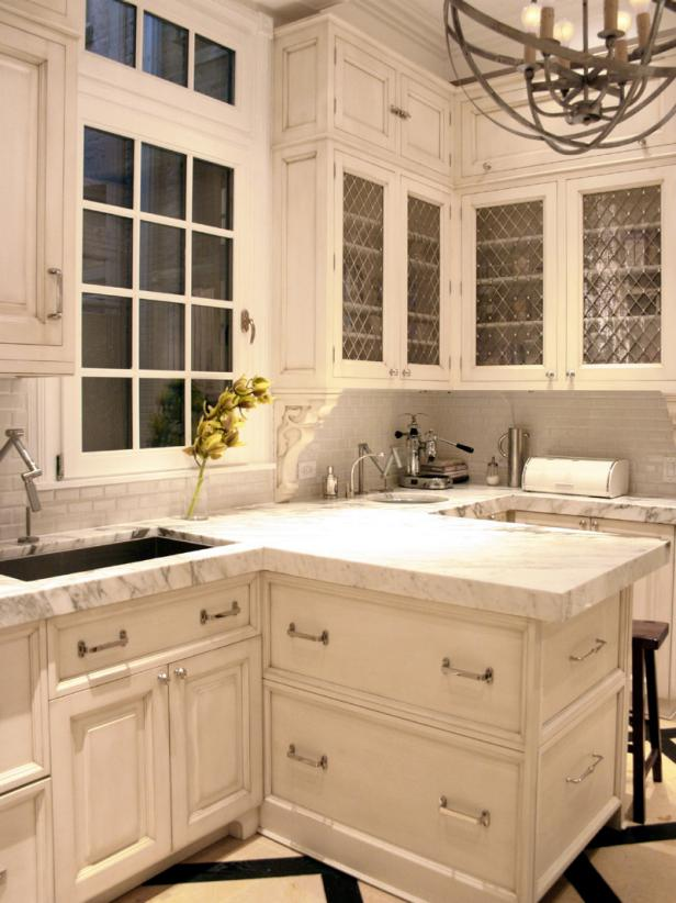 White Kitchen With Scroll Molding Accents And Wire And