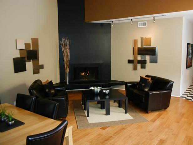 Sleek Sitting Area and Adjacent Dining Space With Black Fireplace