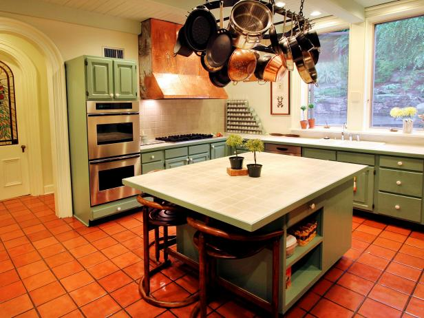 Neutral Kitchen With Green Cabinets and Copper Range Hood