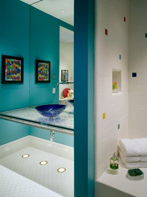 Blue Kids' Bathroom With Floating Vanity and Tiled Shower