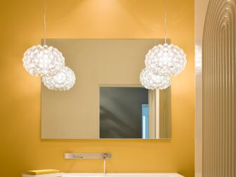 Contemporary Yellow Bathroom With Floating Sink