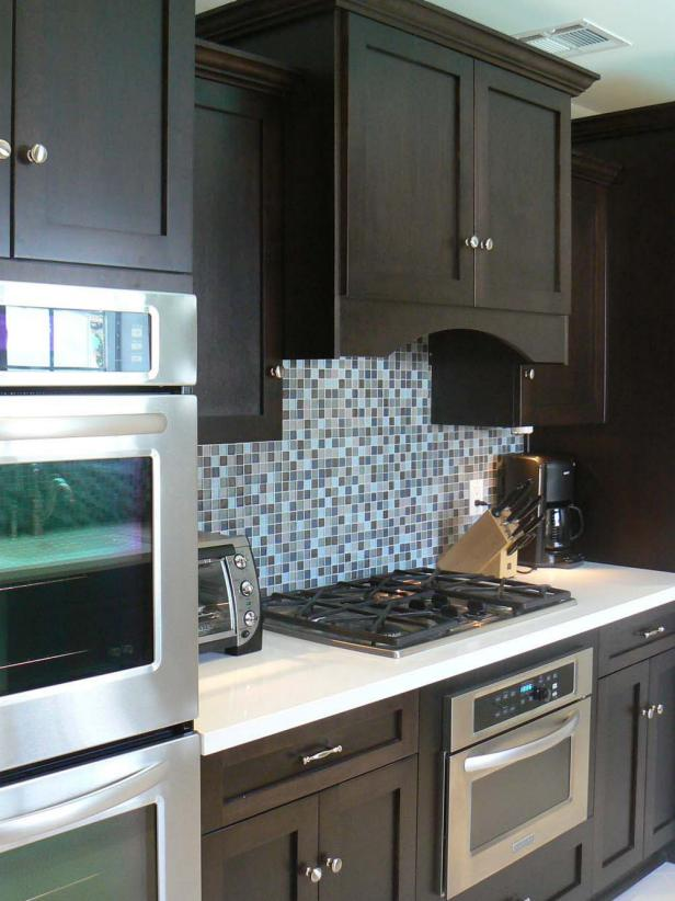 Contemporary Kitchen With Dark Brown Cabinets and Mosaic Tile