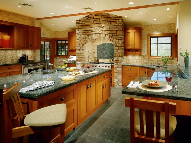 Eat-In Kitchen With Wood Cabinetry and Tall Stone Range Alcove
