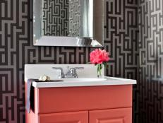 Stylish Bathroom With Graphic Wallpaper and Salmon-Colored Vanity