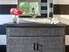 Black and White Striped Bathroom With Gray Vanity