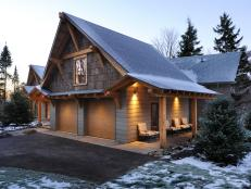Mountain-lodge style extends to the garage, clad in poplar bark siding. Sturdy timbers, constructed on site, add structural support as well as aesthetic value.