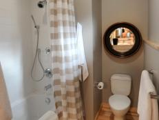 Traditional Guest Bathroom With Striped Shower Curtain