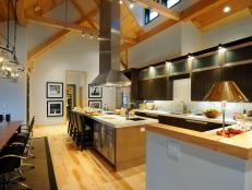 White Eat-In Kitchen With Large Island and Vaulted Ceilings