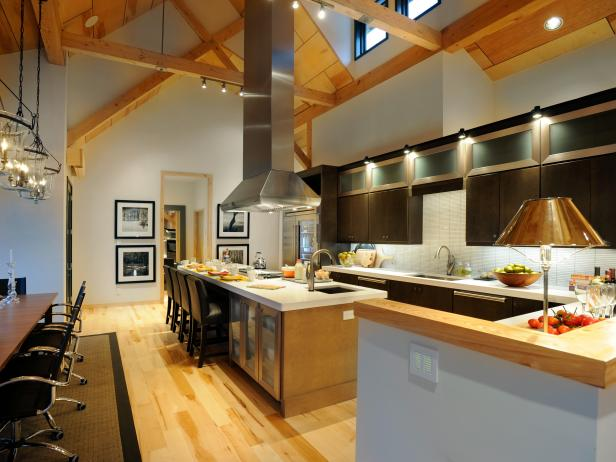 White Eat In Kitchen With Large Island And Vaulted Ceilings