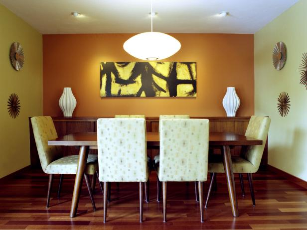 Midcentury Modern Dining Area With Orange Accent Wall