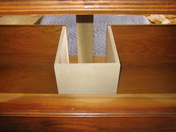 Build a frame that surrounds the cutout on the drawer, keeping it the same height as the existing drawer. This will allow for functional, sliding drawers.