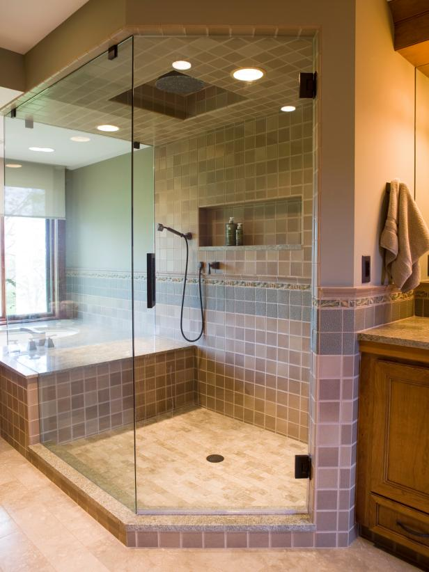 Neutral Toned Glass Shower With Tile Accents and Recessed Shelving