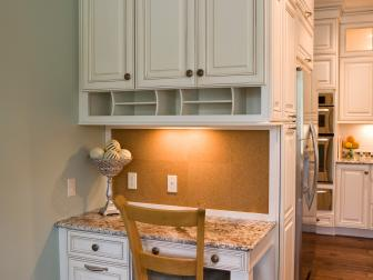 Kitchen Desk Area With White Cabinets and Hardwood Floor