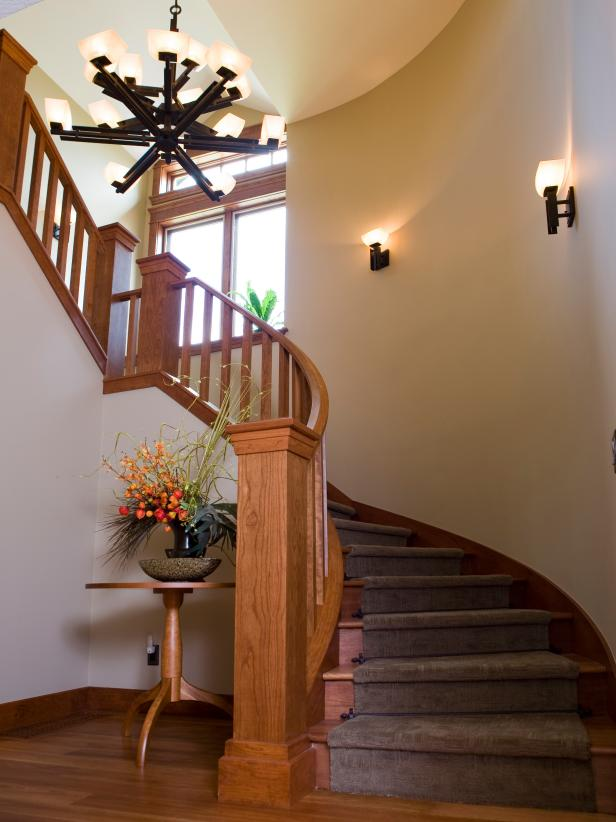 Traditional Entryway With Spiral Staircase and Chandelier
