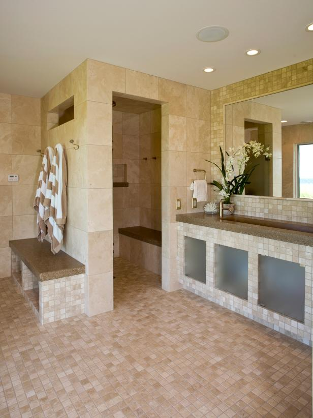 Marble Tile Bathroom With Open Shower and Built-In Benches
