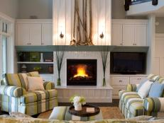 Transitional White and Green Living Room With White Tile Fireplace and Built-Ins
