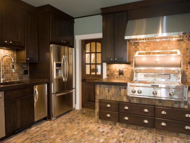 Brown Kitchen With Stainless Appliances and Neutral Tiling