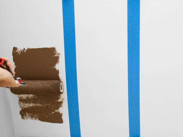 Before painting, protect floor and any furnishings with a drop cloth. Starting from edge of tape, working inward, and paint each taped-off area with accent color. After two coats of first accent color are dry, place a new liner into pan before pouring next color. For side-by-side, two-tone stripes, reposition tape along inside line of completed stripe, then roll between newly positioned tape.