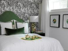 Asian Bedroom With Green Headboard and Patterned Wallpaper Accent Wall
