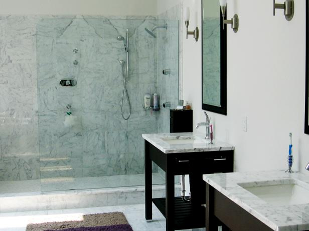 Contemporary Bathroom With Marble Shower and Marble Vanities