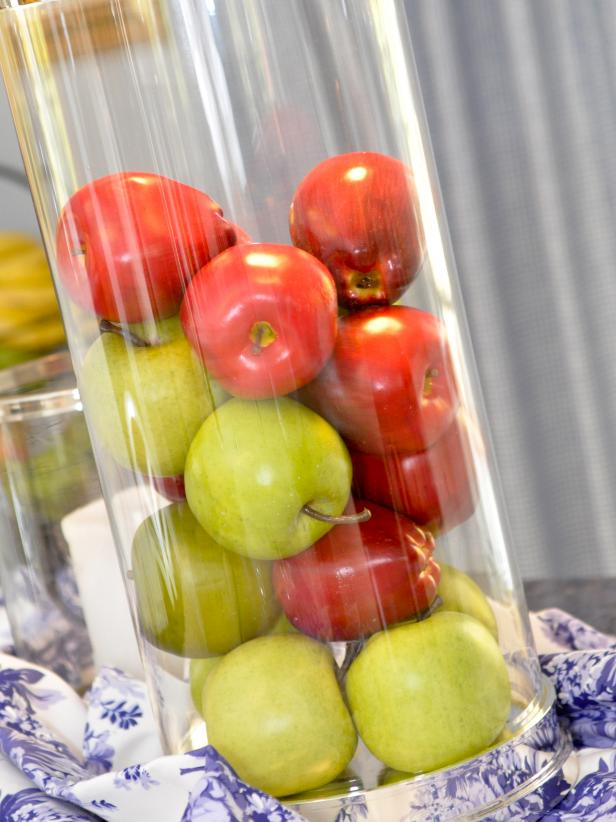 Glass Vessel Centerpiece Filled With Apples on Toile Tablecloth