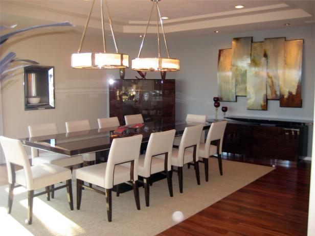 Dining Room With Art Decor and Large Pendant Lights